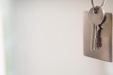 Set of door keys on a blurred background