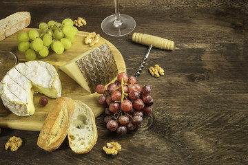 Wine and cheese tasting with bread, grapes and cork