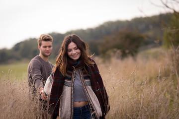 Couple walking in field of corn