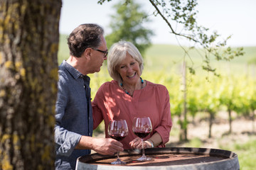 Senior couple visiting a vineyard