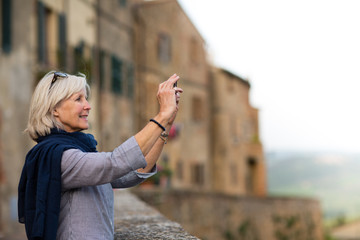 Senior woman on vacation taking a photo
