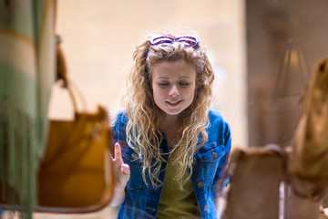 Young female window shopping