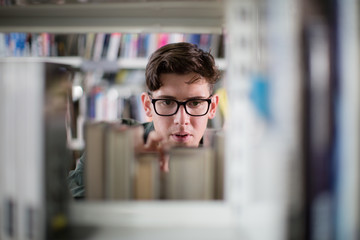 Student looking for a book in library