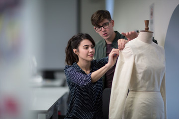 Fashion students working on a design together