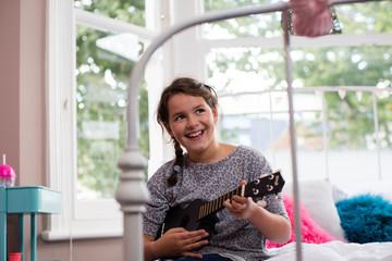 Girl playing a ukulele
