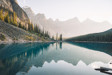 Reflection of mountain peaks on turquoise river