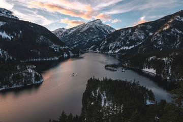 Snow capped mountains and lake at sunset