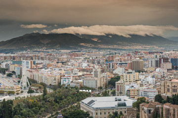 Rolling clouds over Malaga cityscape