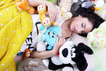 Beautyfull woman sleeping with her soft toys