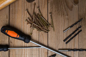 Overhead image of tools, ready for DIY project on a wooden background