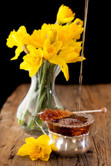Spring tea and bouquet of daffodils