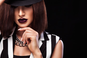 Fashion studio photo of beautiful young lady with black lipstick. Perfect face makeup. Beauty makeup.