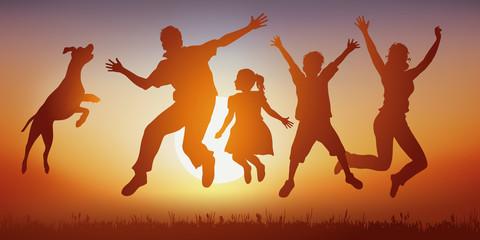 Famille - Bonheur - Coucher de soleil - Saut - Heureux