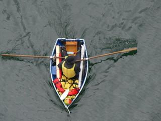 Rowboat top view male ocean