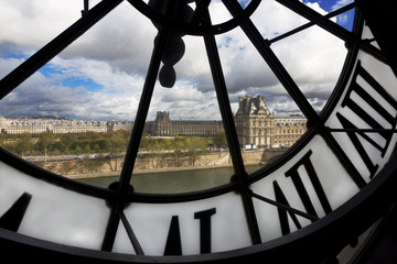 View through giant clock in Musee d' Orsay, Paris, France