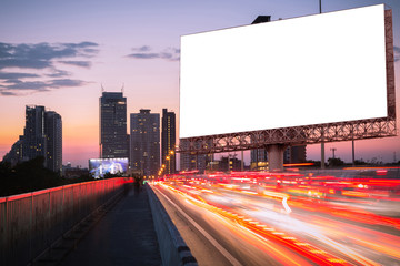 blank billboard with light trails, street, city in the twilight