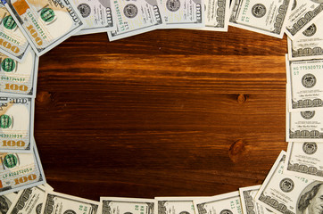 Dollars on a wooden background. dollar top view