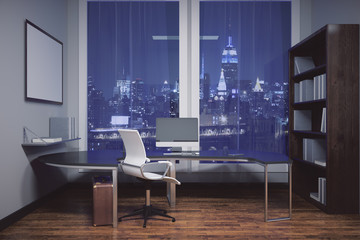 Office with blank picture frame