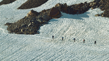 Group of walking Tourists on the Snowfield