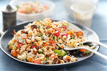 Cauliflower, quinoa & harissa spiced chickpeas with feta and mint dressing