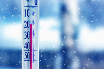 Thermometer shows winter cold. Low temperature
