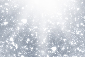 Snowflakes rays and bokeh or glitter lights on silver background. Christmas abstract template