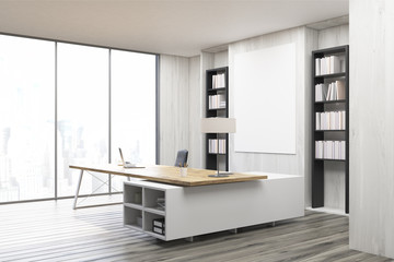 Side view of a CEO office with gray walls