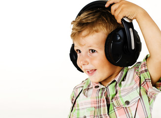 young pretty little cute boy kid wondering, posing emotional face isolated on white background, gesture happy smiling close up, wearing headphones, lifestyle people concept