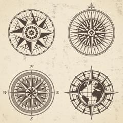 Set of vintage antique wind rose nautical compass signs labels emblems elements.
