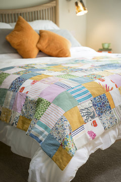 Patchwork Linen on a Huge Bed