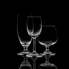 Shot of empty crystal wineglasses on black isolated.