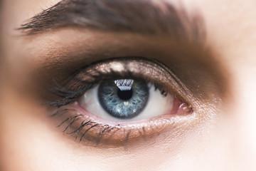 macro photo of the young woman's eye