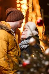 Beautiful couple cuddling on winter