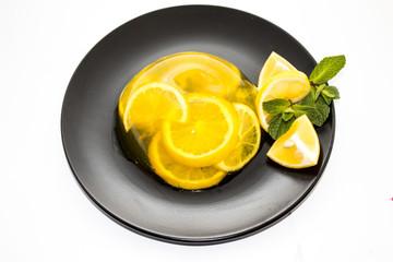 Fruit jelly on dark plate