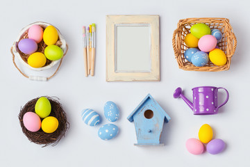 Easter holiday eggs decorations and photo frame for mock up template design. View from above. Flat lay