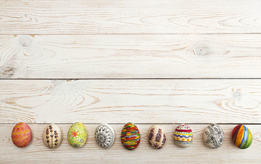 Holiday background with colorful painted Easter eggs