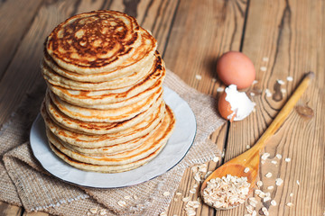 High stack of Oatmeal pancakes