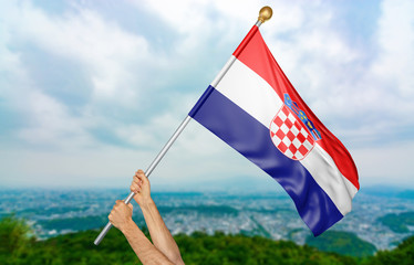 Young man's hands proudly waving the Croatia national flag in the sky, part 3D rendering