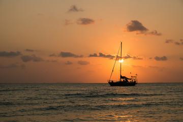 boat sailing sunset