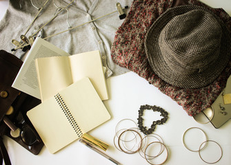 Opened notebook for memories near vintage hat