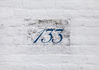 photo of numbers on one of the brick white buildings