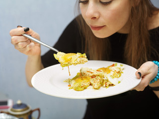 Young Girl Eating Scrambled Eggs