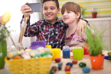 boy and girl  taking selfie at Easter time