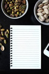 Pistachio with blank notepad