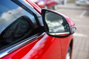 Car mirror red car