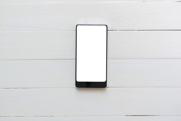 phone tablet on white wood background