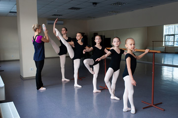 Children engaged in choreography at the ballet school.