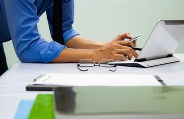 Businessman working at office. Digital tablet laptop computer smart phone using, keyboard. Connection internet application online. Finance manager. Banking.