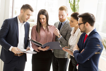 View at business partners analyze the business results in modern office