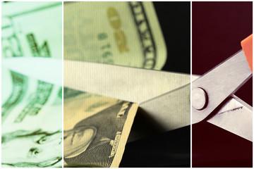 Scissors cutting American currency twenty dollar bill - Budget cuts financial crisis concept